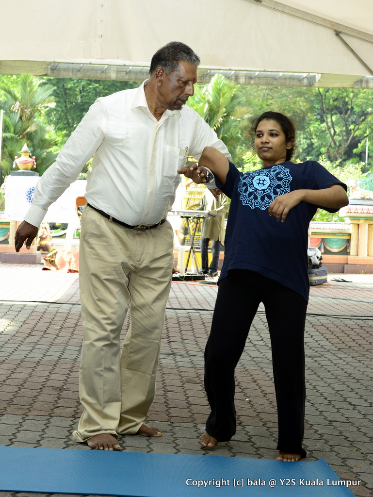 Gurukkal demonstrating self-defense techniques, with Aditi Manoharan